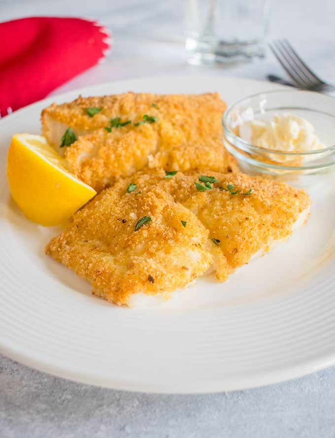 breaded fish with lemon and mayo