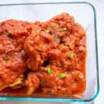 bowl of ribs with tomato sauce