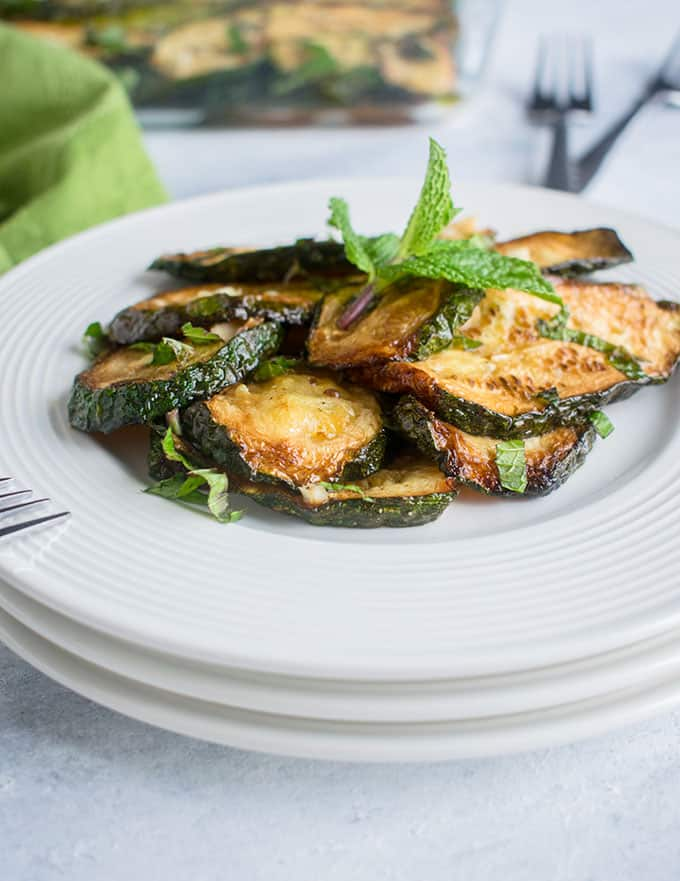 portion of cooked zucchini with mint leaves
