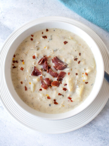 overhead view of soup in bowl with bacon