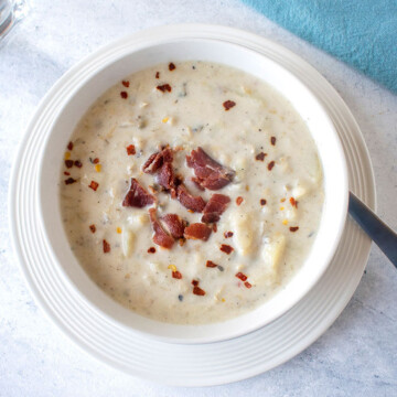 closeup view of bowl of chowder with bacon