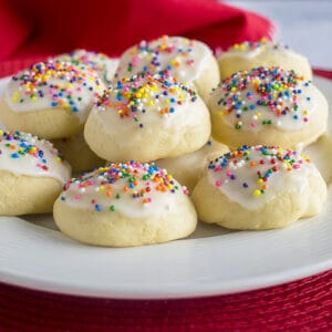 plate of glazed cookies with sprinkles