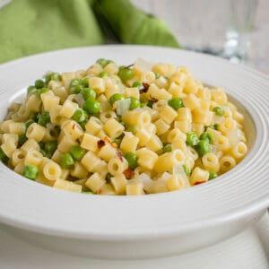 bowl of ditalini pasta with peas