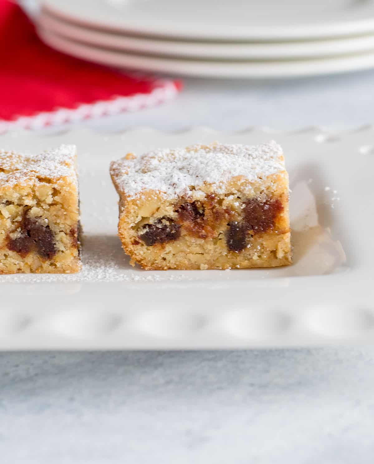 Chinese Chews cookie bars on platter with powdered sugar