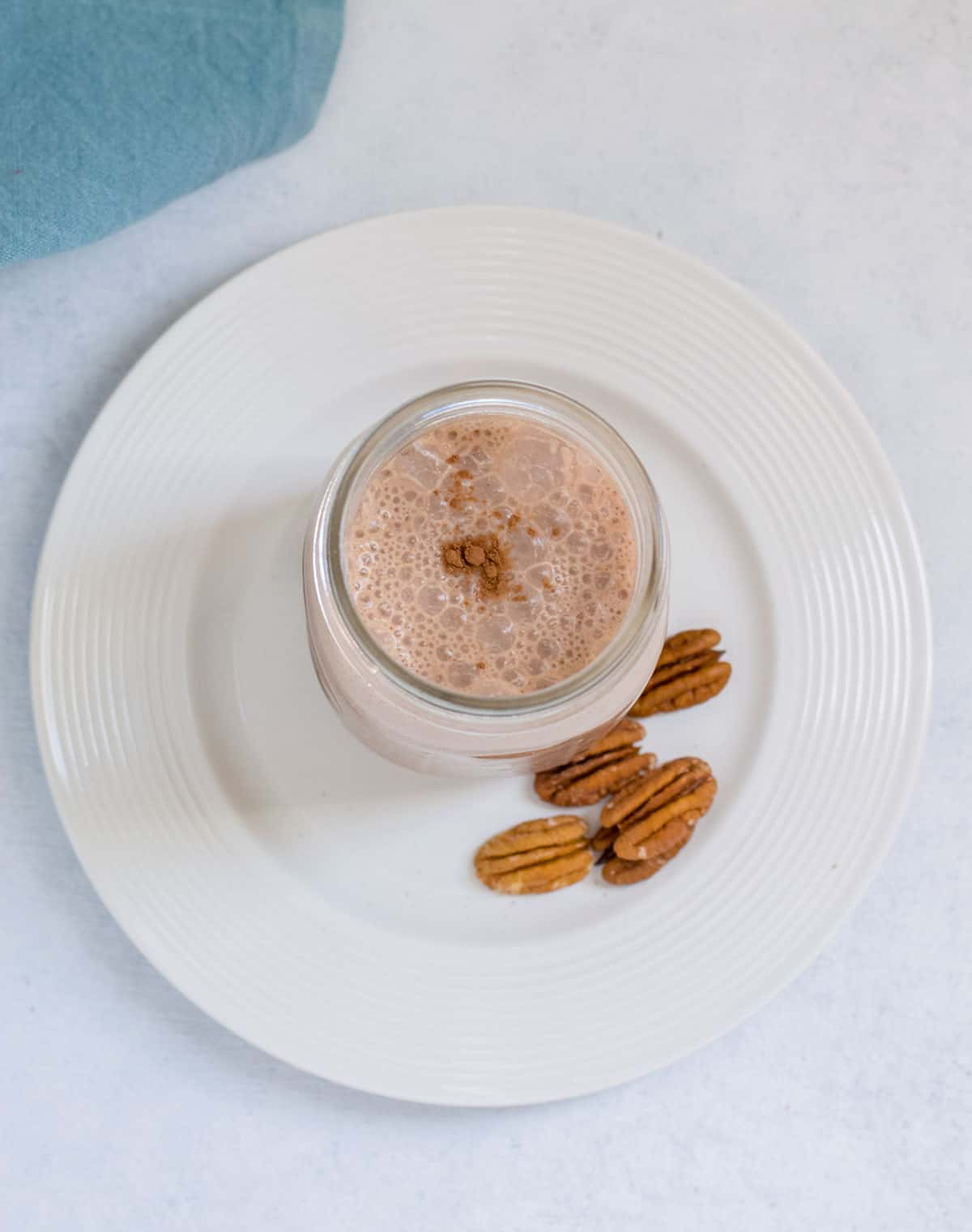 foam on top of chocolate smoothie with pecans