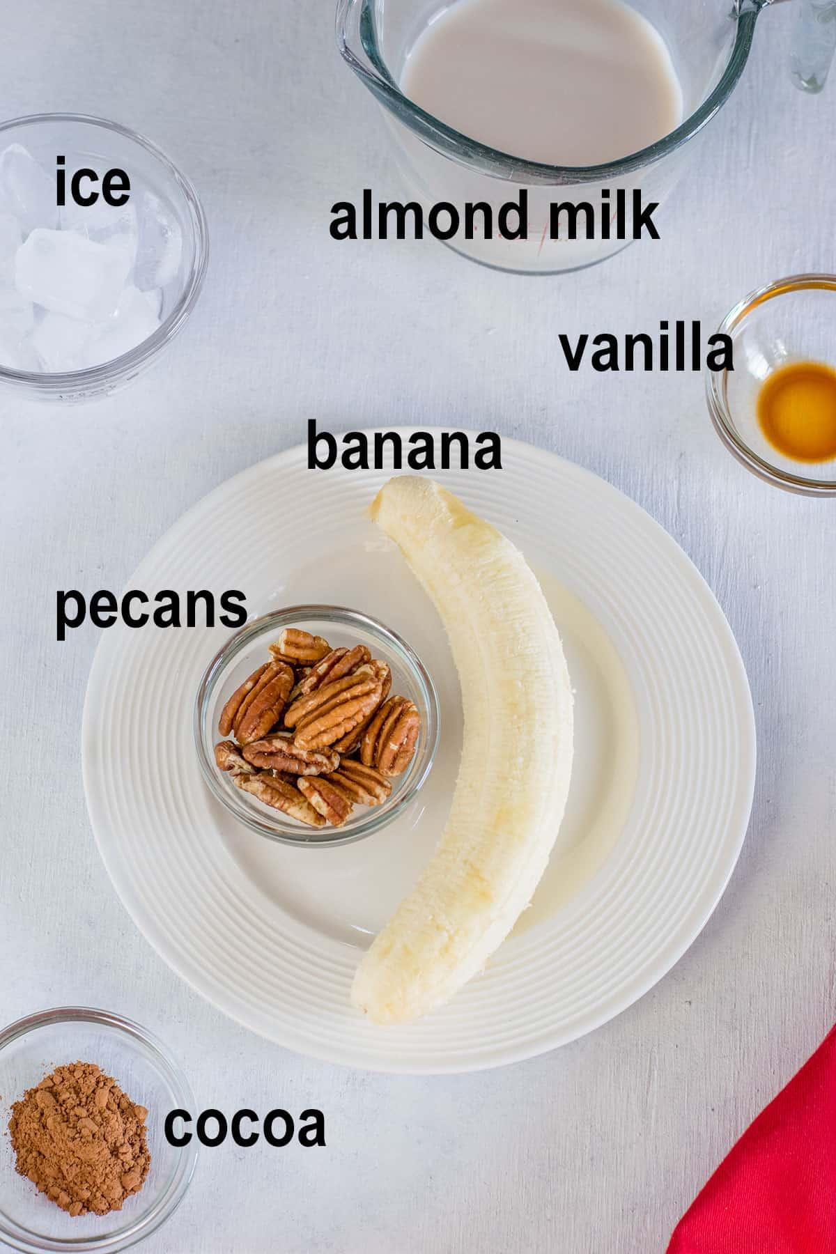 banana, pecans, almond milk, cocoa, vanilla, ice