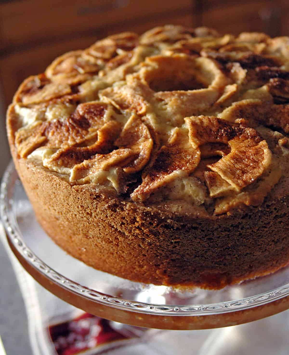 closeup of apple cake on a glass stand