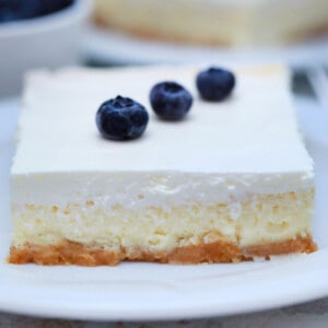 slice of square cheesecake with sour cream, blueberries