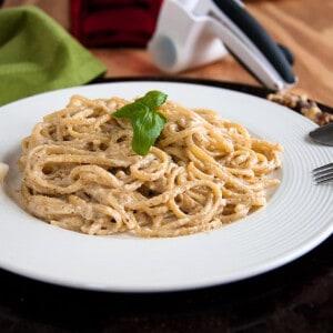 plate of creamy spaghetti with basil