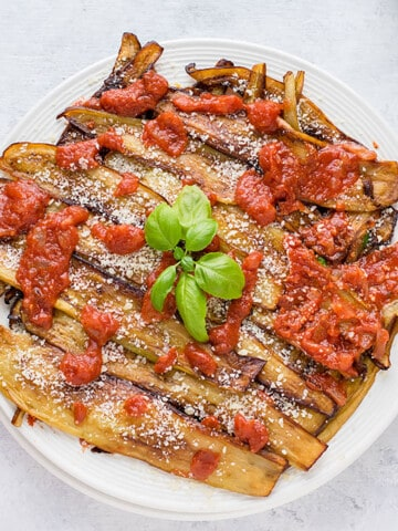 cooked eggplants with tomato sauce and basil