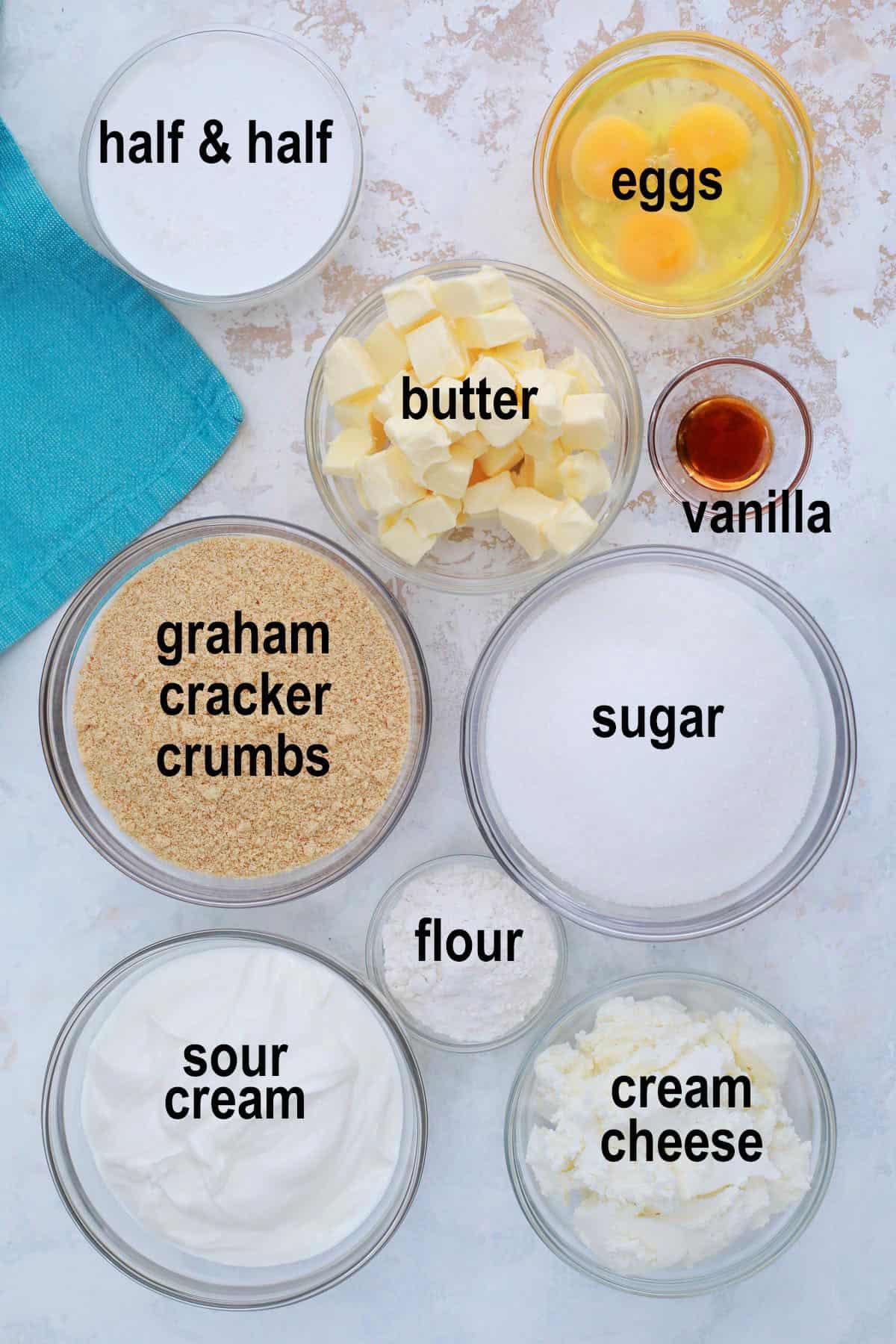 crumbs, sugar, butter, vanilla, flour, cream cheese, sour cream, eggs