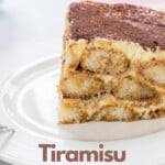 large slice of tiramisu on white plate