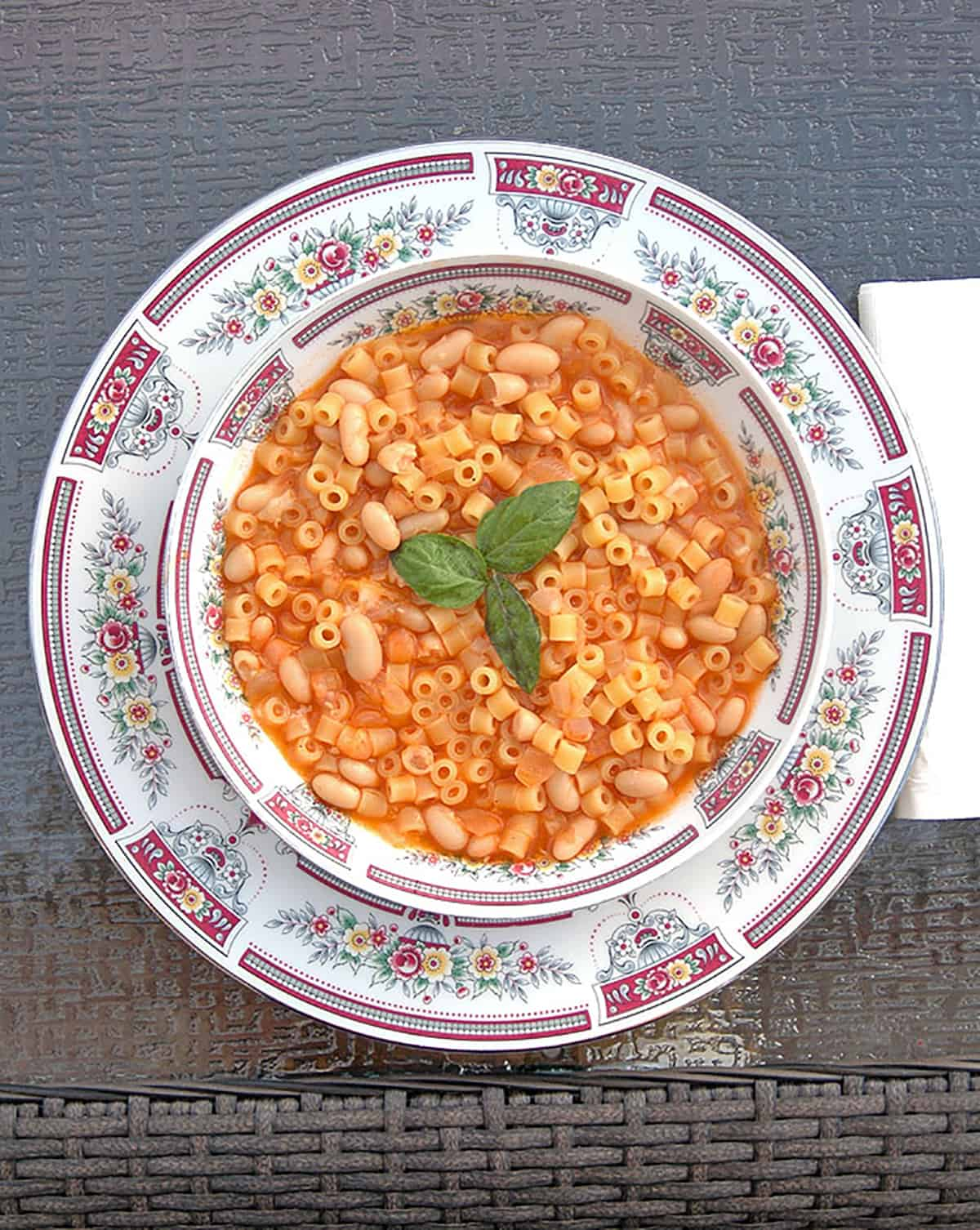 bowl of ditalini with white beans in tomato broth