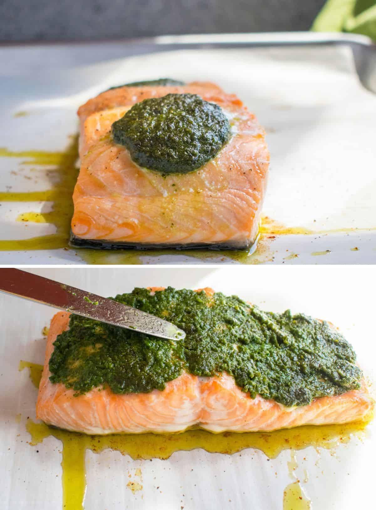baked salmon with pesto on top, knife spreading pesto on salmon