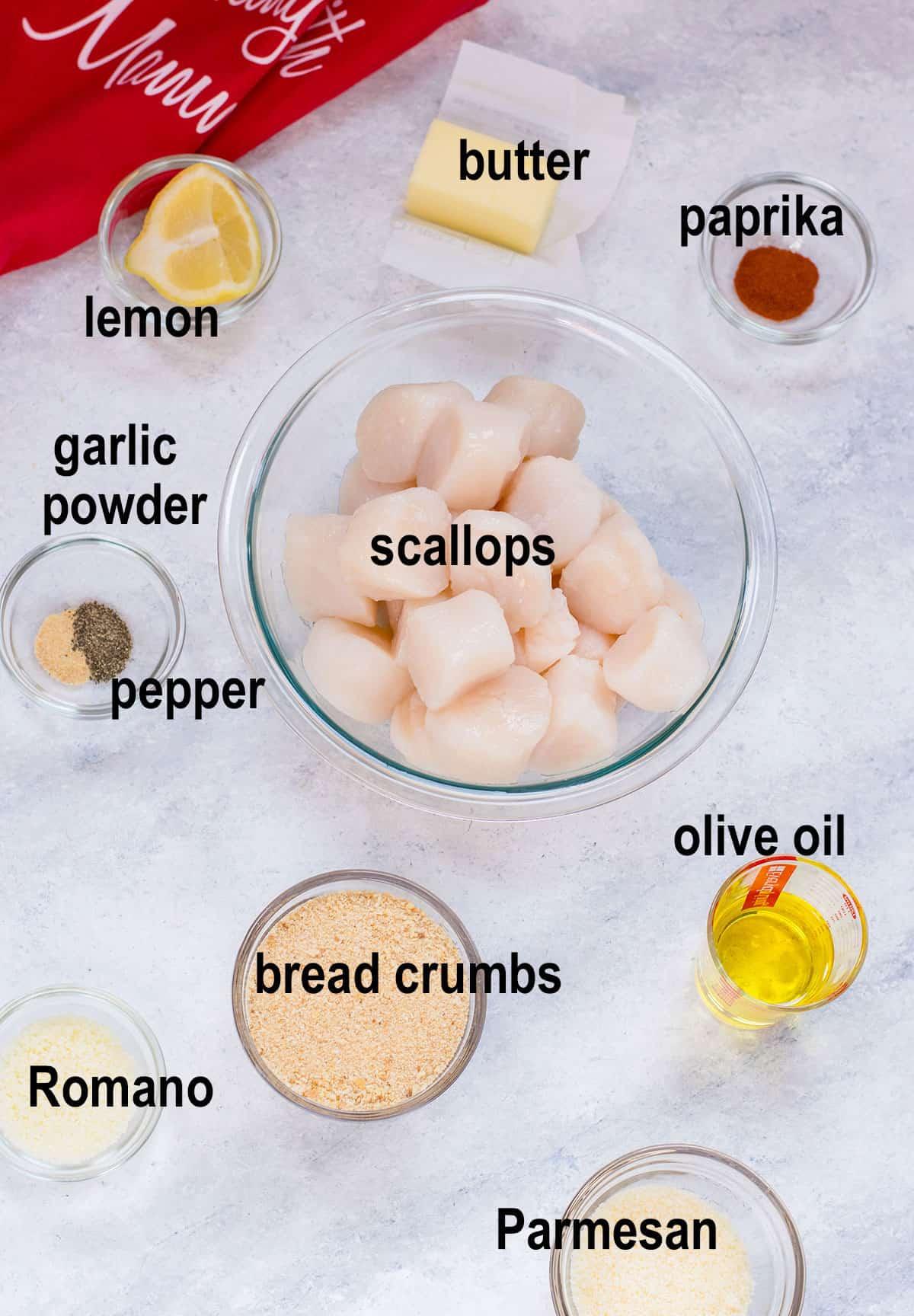 scallops, cheese, oil, bread crumbs, seasonings, lemon, butter