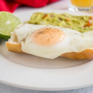 basted egg on bread with lime and guacamole toast
