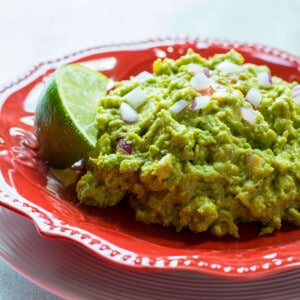 guacamole on red plate