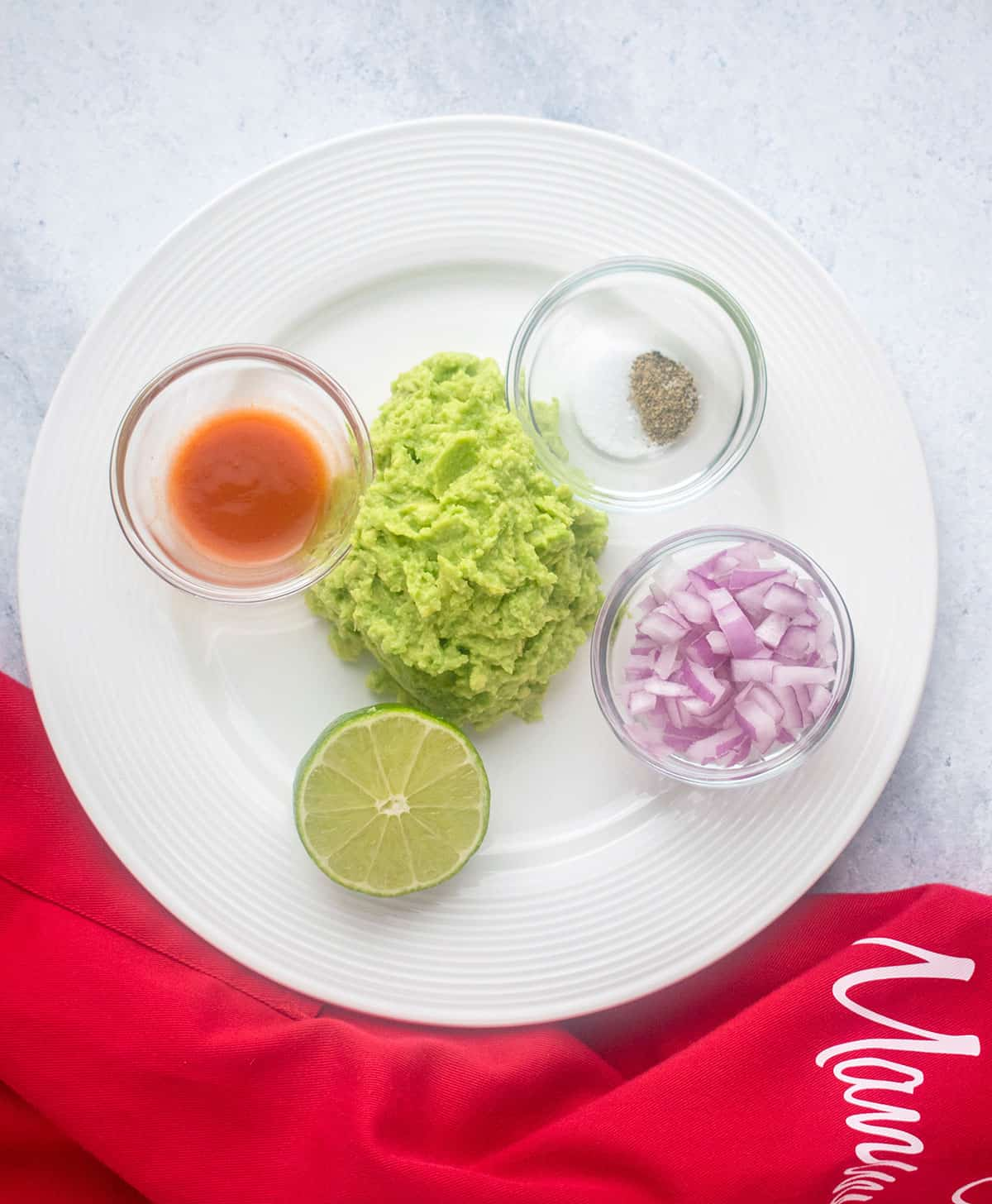 mashed avocados, red onions, lime, hot sauce, salt, pepper