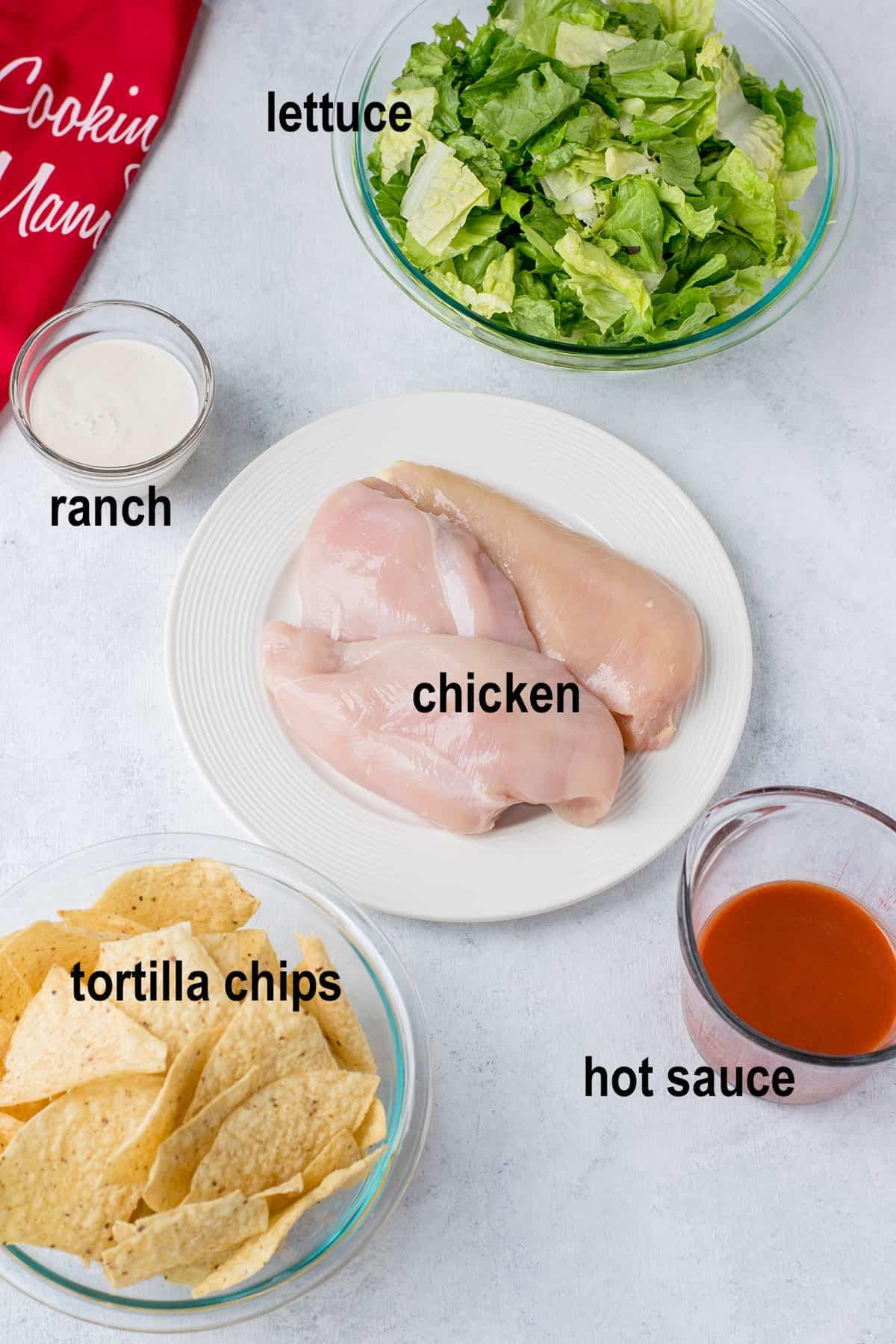 lettuce, raw chicken breasts, hot sauce, tortilla chips, ranch dressing