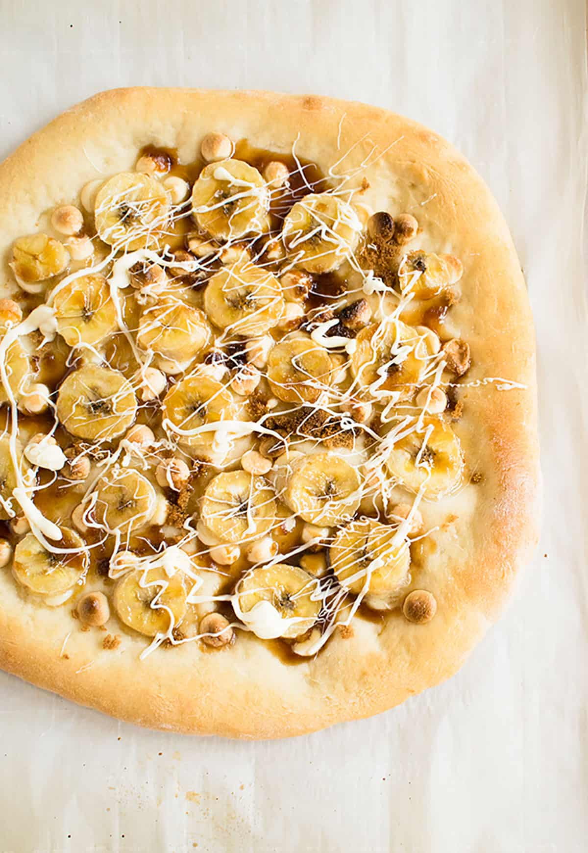 overhead view of banana pizza with white chocolate