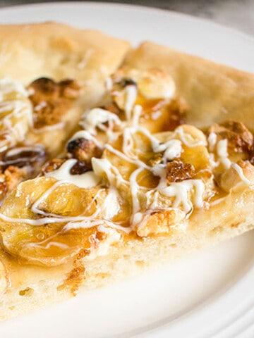 closeup of banana pizza with white chocolate