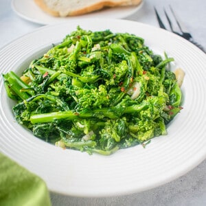 cooked rapini in white bowl