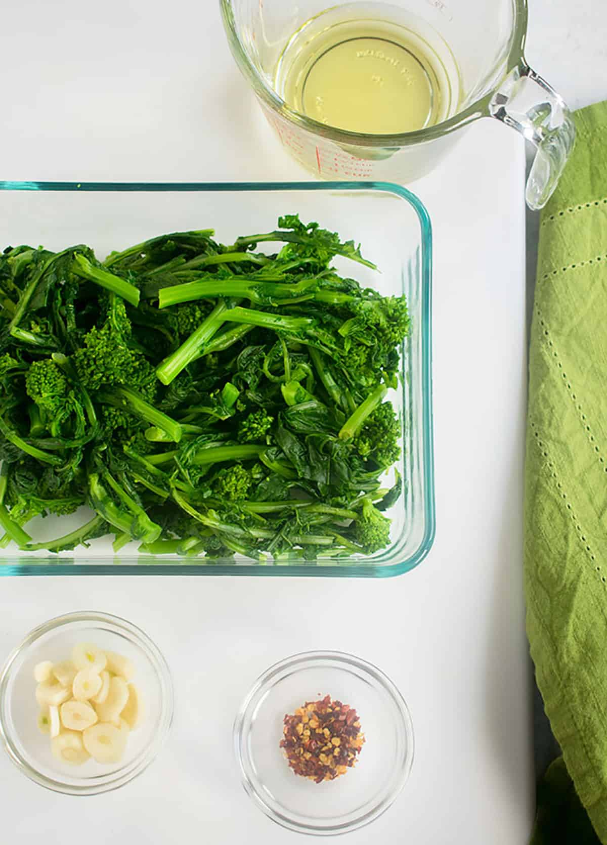 oil, boiled rapini, garlic slices, red pepper flakes
